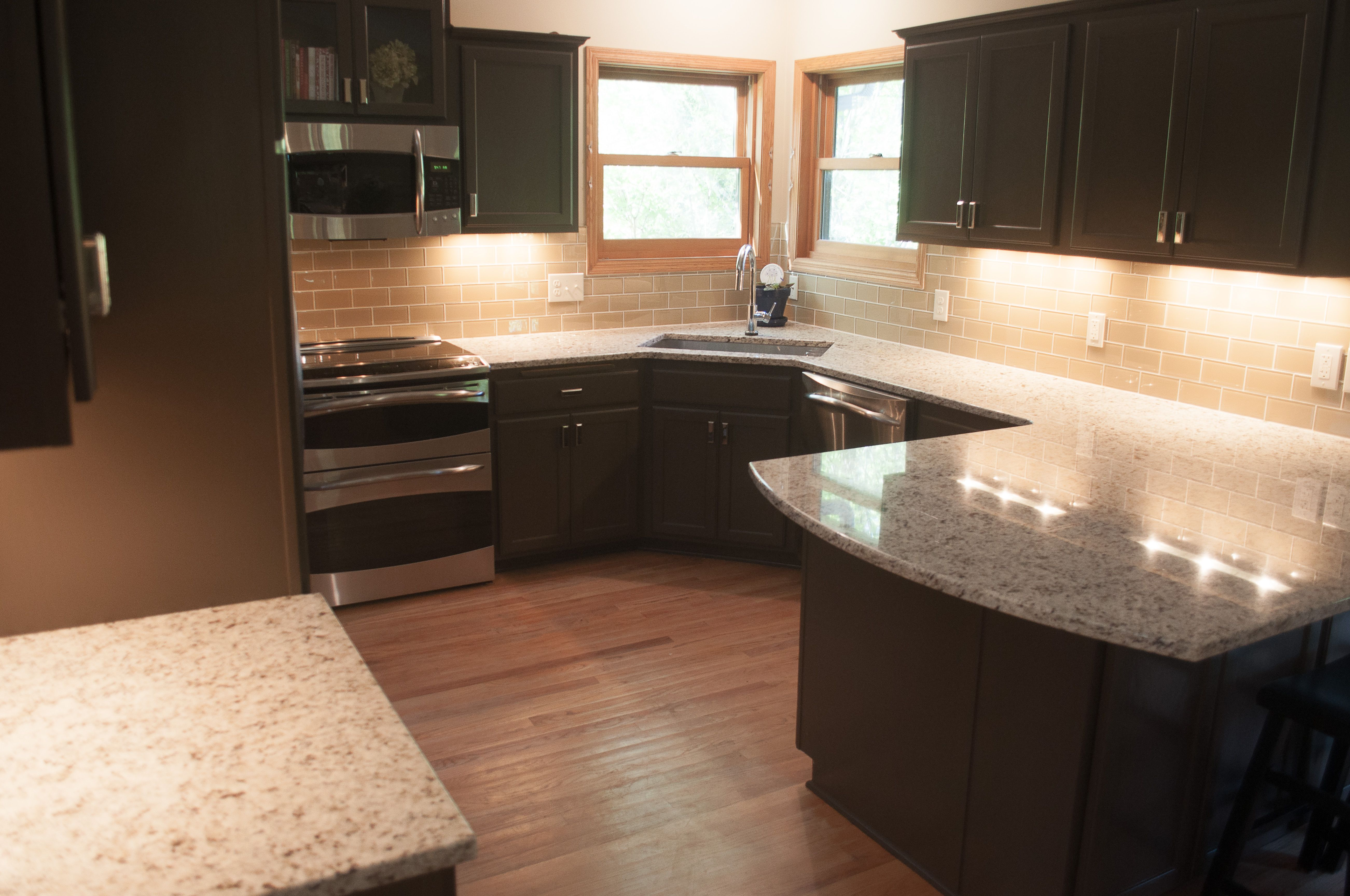 after from golden oak Black kitchen decor