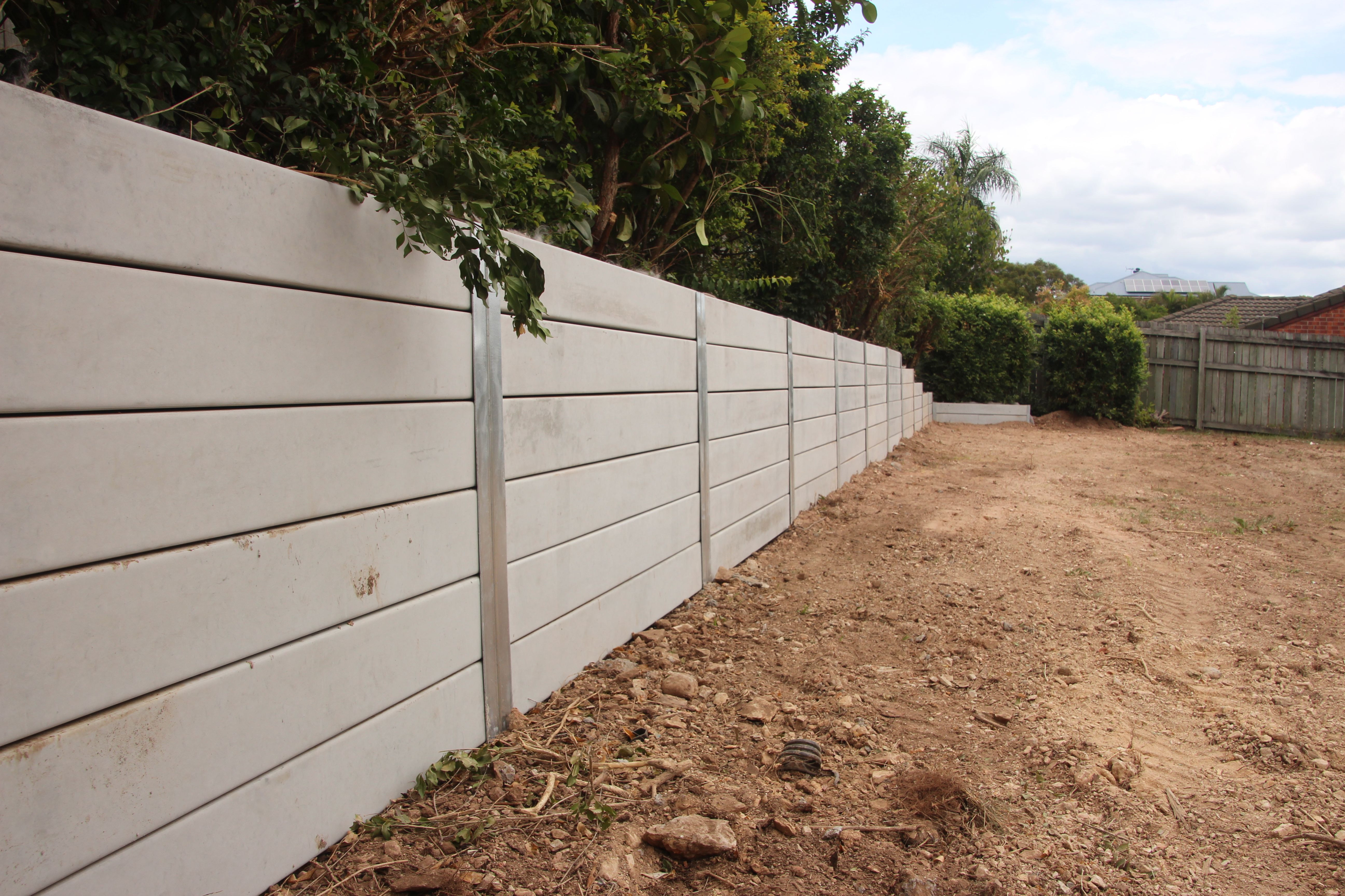 Pioneer Smooth Grey Concrete Sleeper Retaining Wall Visit Www Aussieconcreteproducts Co Backyard Retaining Walls Concrete Sleeper Retaining Walls Fence Design