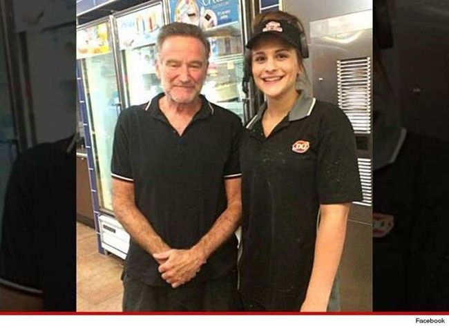 Final image of Robin Williams posing with a fan.