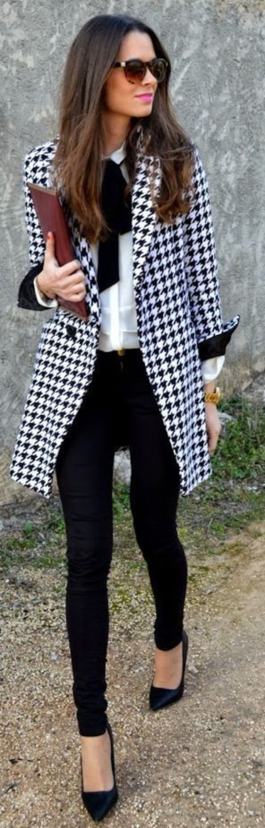 Black and white houndstooth coat, white blouse with black bow, black skinny  cut trousers, oxblood clutch, and black heels