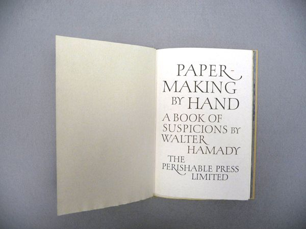 Hand Papermaking: Papermaking by Hand. Minor Confluence, Wisconsin: 1982. Perishable Press, Walter Hamady. Title page lettering by Hermann Zapf.