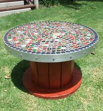 repurposed cable reel wooden cable drum reel coffee table with beer caps industrial upcycled. Black Bedroom Furniture Sets. Home Design Ideas