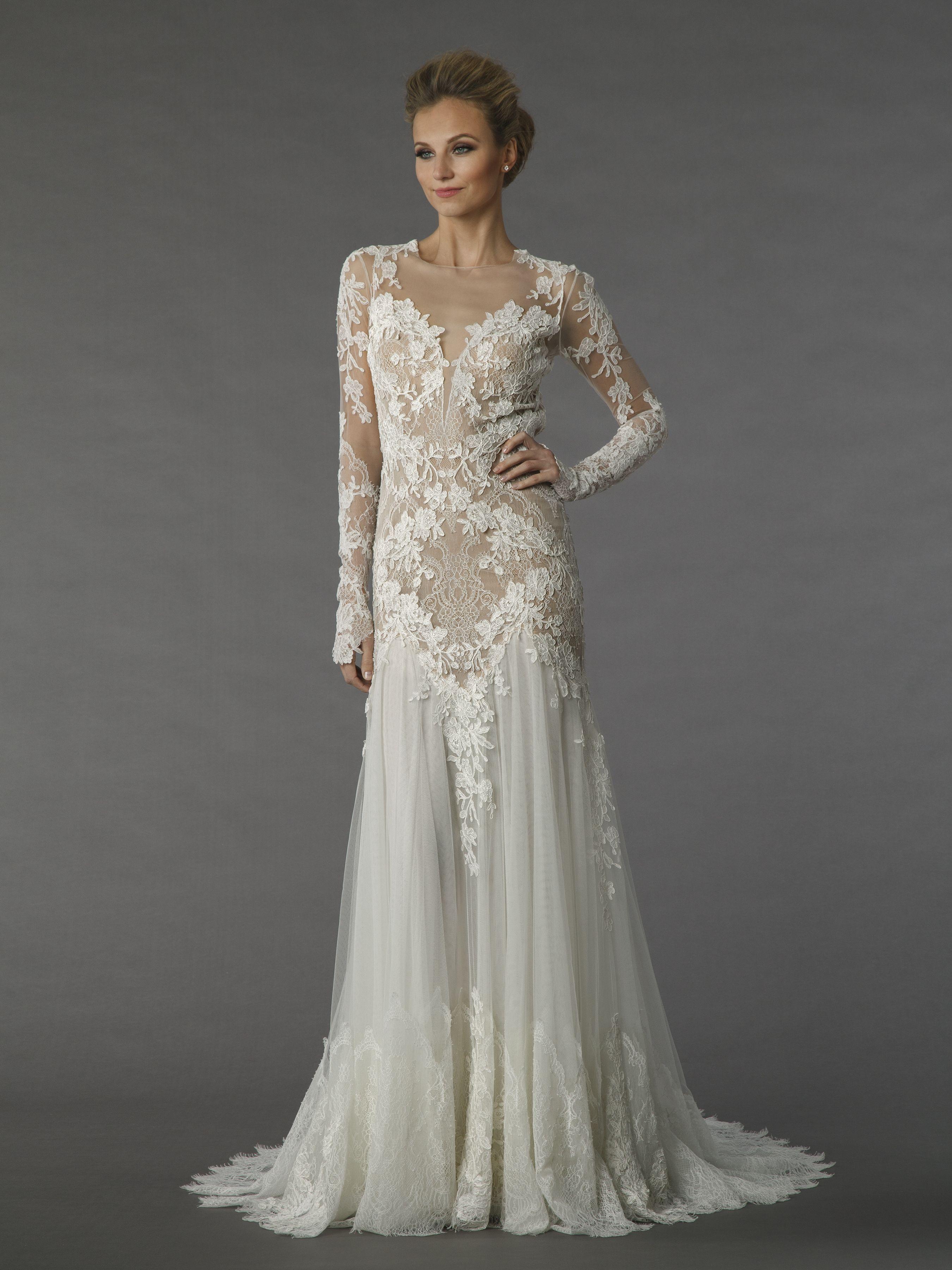 e5c27b7b94d Long sleeve illusion lace wedding dress.