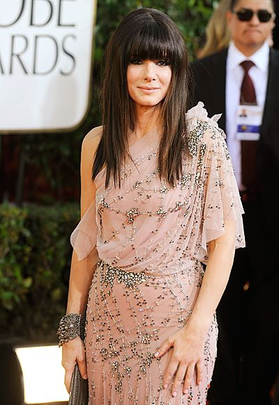 The Most Brilliant Golden Globes Jewelry of All Time - Sandra Bullock, 2011 from InStyle.com