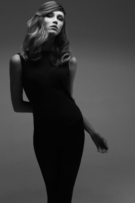 Gorgeous source lighting black and white studio model simple black dress