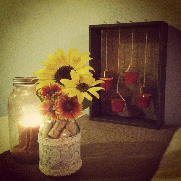 Burlap table runner and a decorative mason jar candle holder and vase complete the shadow box!