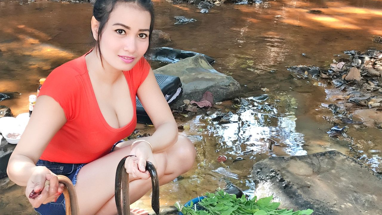 Asian girl with eels