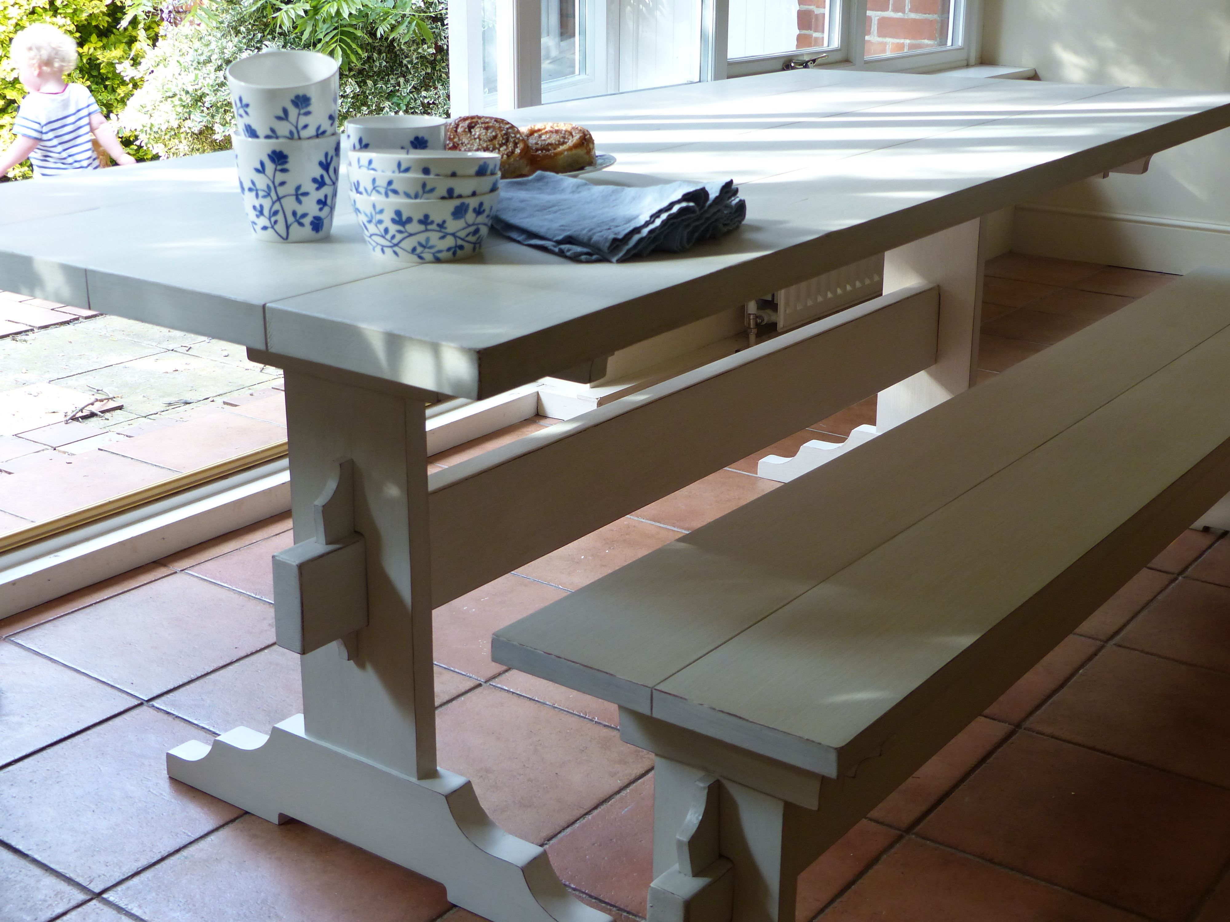 Handpainted trestle dining table in soft white with