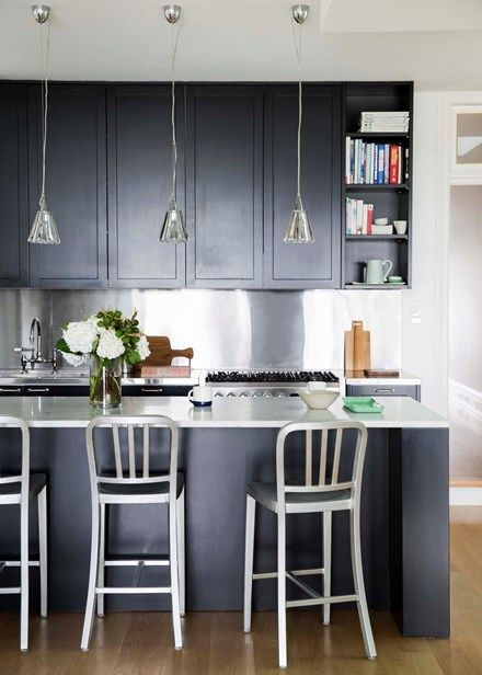 A Contemporary Matt Black Stainless Steel And Marble Kitchen