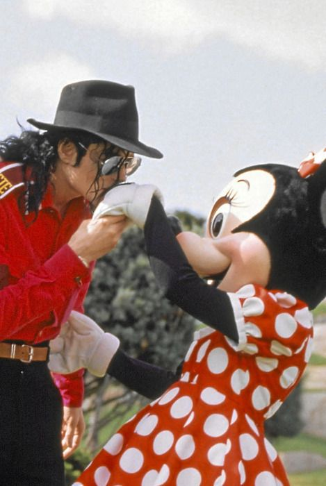 MJ kissing Minnie Mouse on the hand