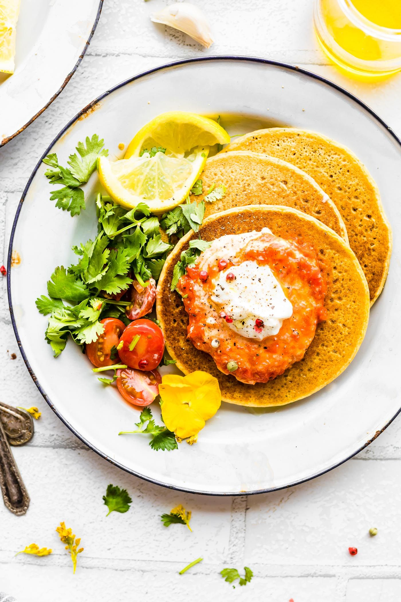 Chickpea Pancakes with Harissa Yogurt Sauce Weekday pancakes suitable for dinner? Sure, why not! These Chickpea Pancakes with Harissa Yogurt Sauce are wholesome and quick to make. A Chickpea flour pancake (Similar to Socca) with a thick and creamy spicy Yogurt topping. grain free, rich in protein and calcium!