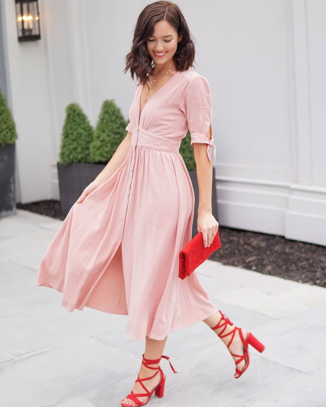 peach dress and red shoes