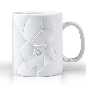 This coffee mug is made to look cracked and glued back together.