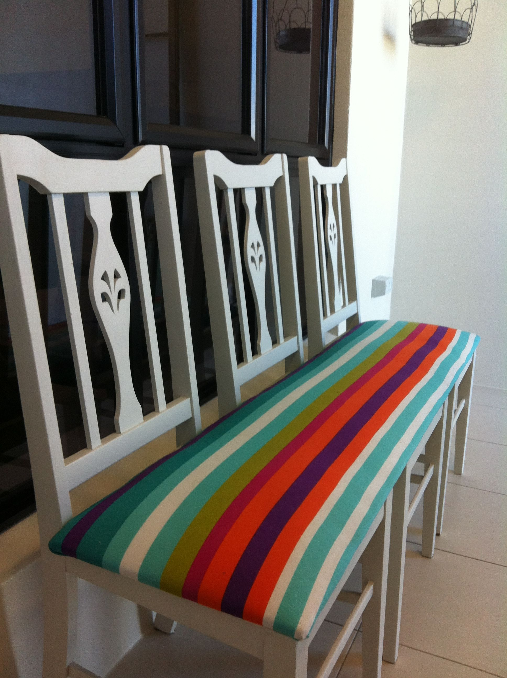 3 Wooden Chairs 1 Board Bright Coloured Fabric