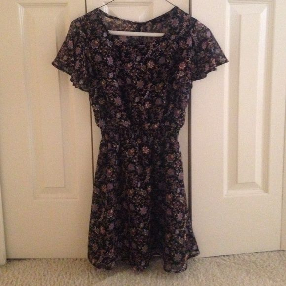 F21 FINAL PRICE Floral Dress NOT Brandy Melville, it's from Forever 21, said BM for visibility. Only worn once for a wedding reception. Has a little extra stitching as pictured in bottom picture, but not very noticeable. Still in great condition. Has a keyhole in the back, elastic waistband, and is flowy. Sleeves are sheer. Does look like it has a built in slip as this dress would be very see the through without it. Super pretty and needs a new home! Brandy Melville Dresses