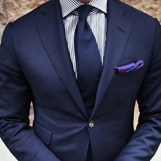 146be693629689 Follow @gentsinsider TAILORED FIT Navy suit paired with a white striped  shirt, with a navy tie, and a purple pocket square.