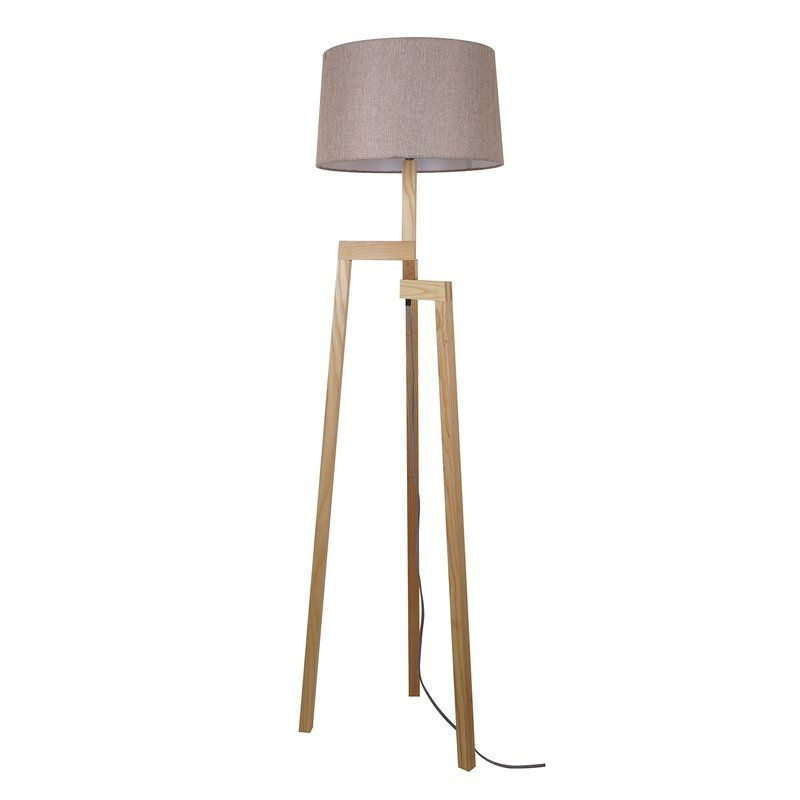 Appreciate the natural appeal of the Elayna floor lamp. Ideal for a casual, inviting family room, this lamp features a natural wood finish over an angular base with a trio of angled legs. Resting on top, an off-white linen drum shade creates warm, diffuse illumination that works beautifully in a relaxed interior space. This floor lamp stands to make an impression, without ever expecting to take center stage in your interior.