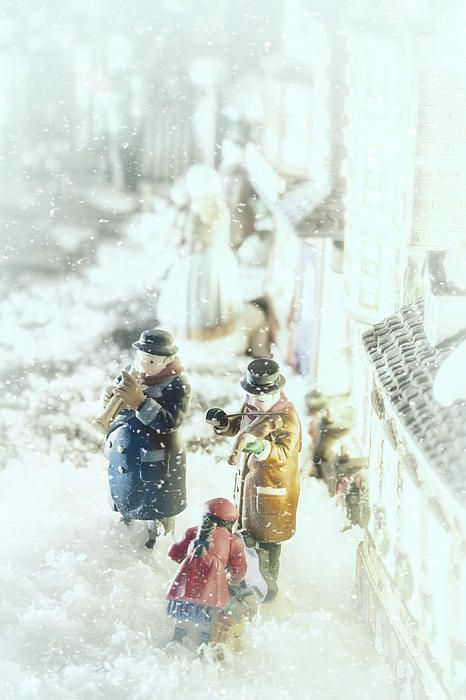 """""""Concert In The Snow"""" by Caitlyn Grasso. A snow scene from Victorian England to warm the heart! A little girl is bending down to thank some very cold street musicians for their beautiful music with a coin. What is the song? I'll leave that to your imagination!"""