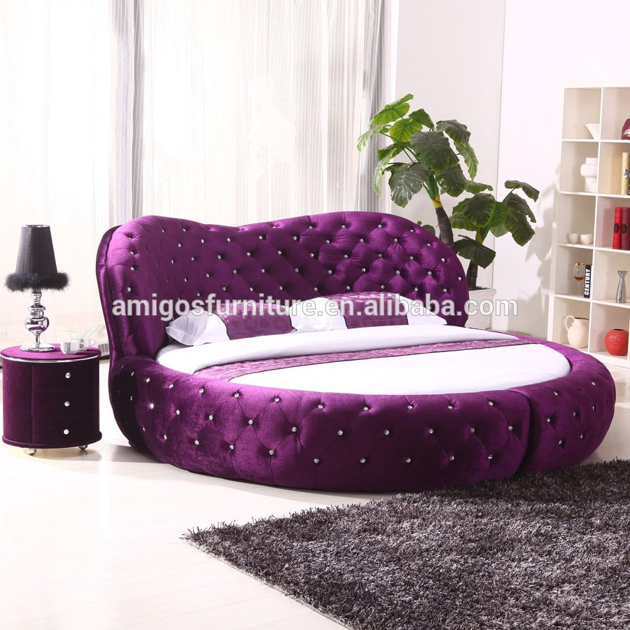 King size leather bed with automatic tv lift tv bed frame for Round bed design images