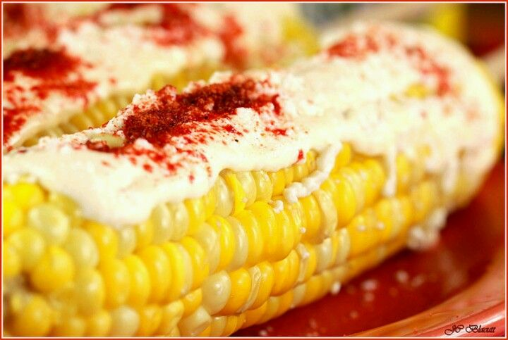 Corn on the cob with mayo ,cheese & chile.