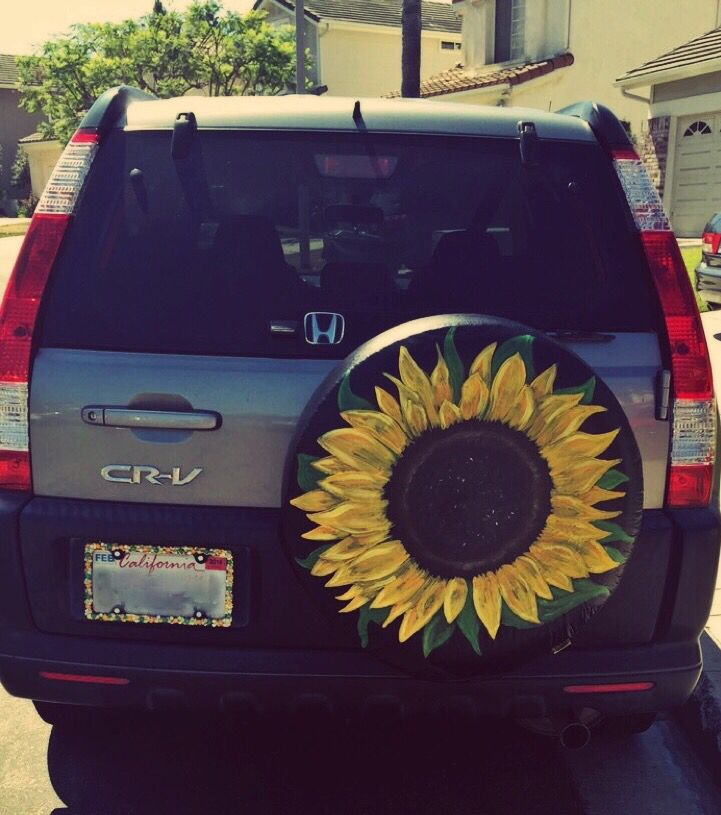 Update Your Car With A Diy Facelift Hand Painted Tire Cover With A Bedazzled Matching License Plate Cover Sunflowers Jeep Tire Cover Cute Cars Painted Tires
