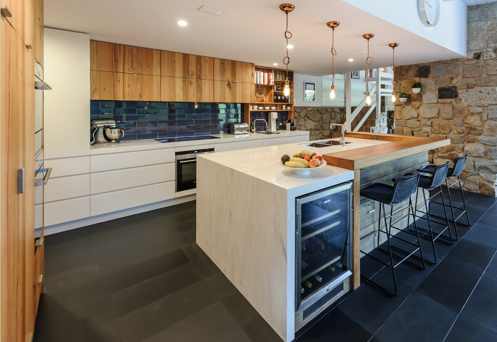 Homey Kitchen the mix of warm timber wood and corian® countertops gives this