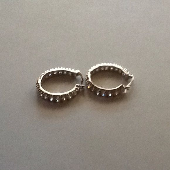 """Prong Set Diamond CZ Silver Bold Hoop Earrings Beautiful simulated diamond round hoop earrings.  Approx. 7/8"""".  Snap safety closure.  The diamond like stones go all the way around the hoop.  Look real. Great quality. Amazing in person! Jewelry Earrings"""