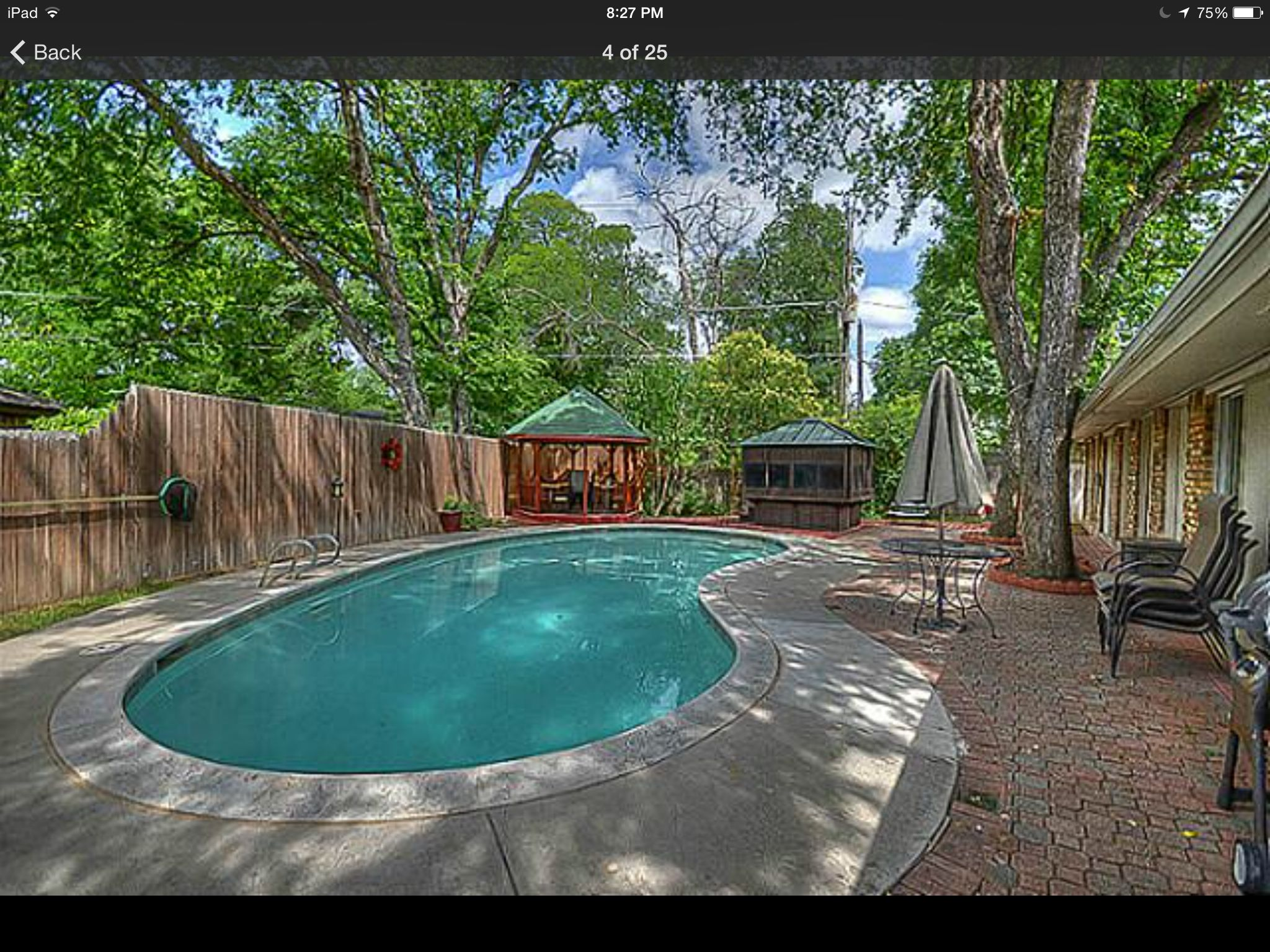 Pool with all concrete and stone in yard, small areas of dirt and ...