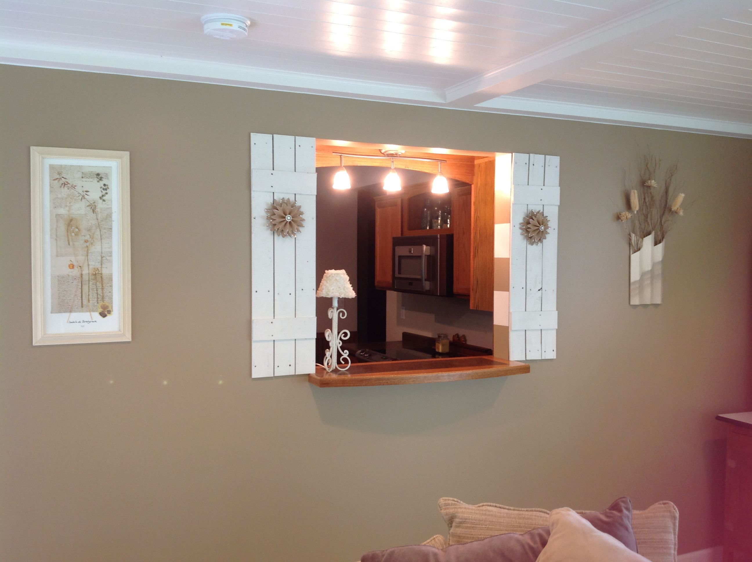 Wall In Sunroom With Pass Through Window From Kitchen Shutters