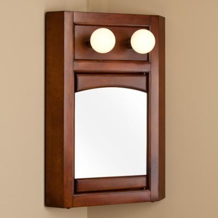 Lighted Corner Medicine Cabinet With Mirror   Cherry. The Lights Sort Of  Ruin The Effect.