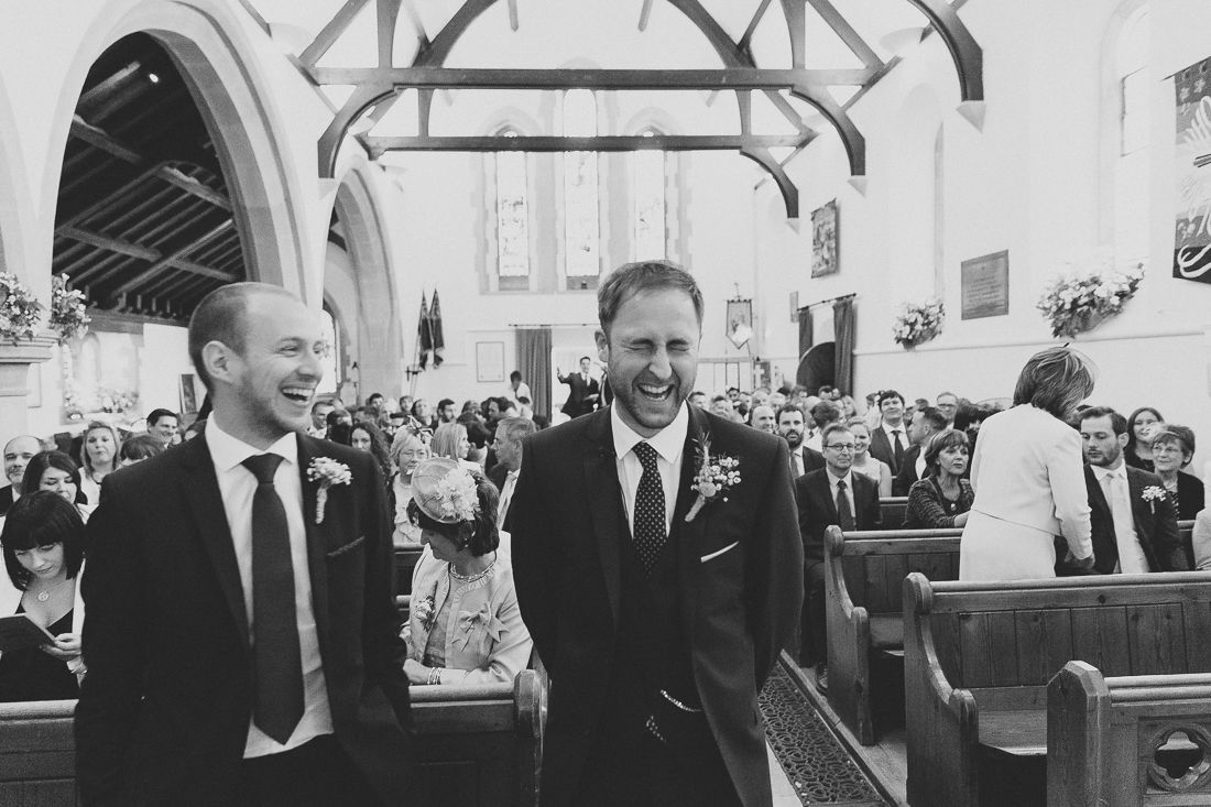 Groom and best man caught moments before the bride walks down the aisle | Chris Scuffins Photography | For more visit www.weddingsite.co.uk