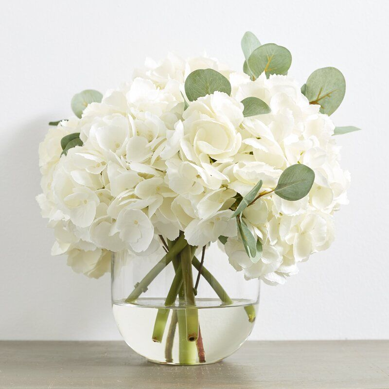 Large White Hydrangea Eucalyptus Arrangement In Rounded Glass Vase In 2020 White Floral Arrangements White Flower Arrangements Flower Arrangements Simple