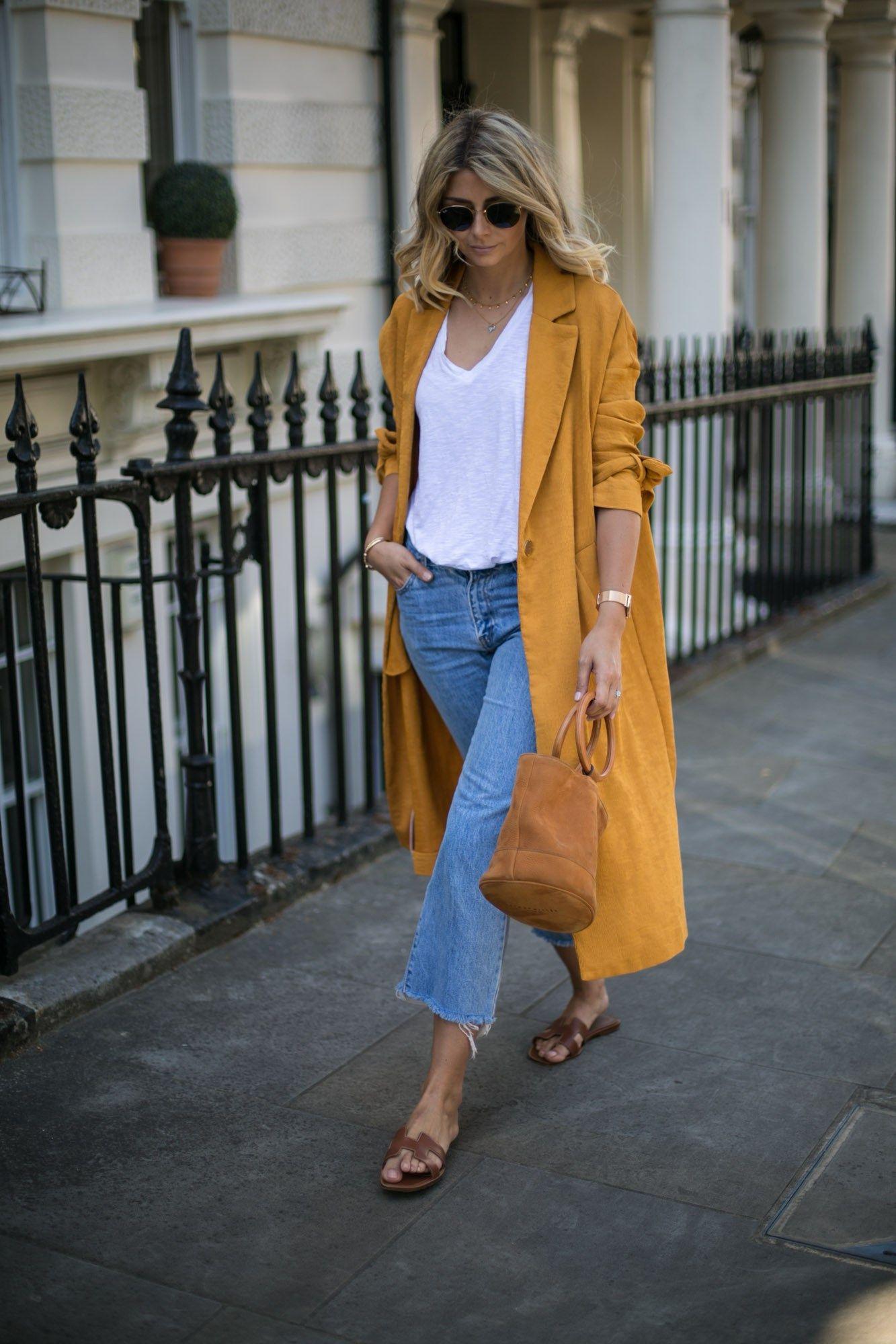 e94193e04de Emma Hill wears Mustard duster coat, cropped frayed jeans, Hermes Oran tan  leather sandals, basic white t shirt, Simon Miller Bonsai bag, summer outfit