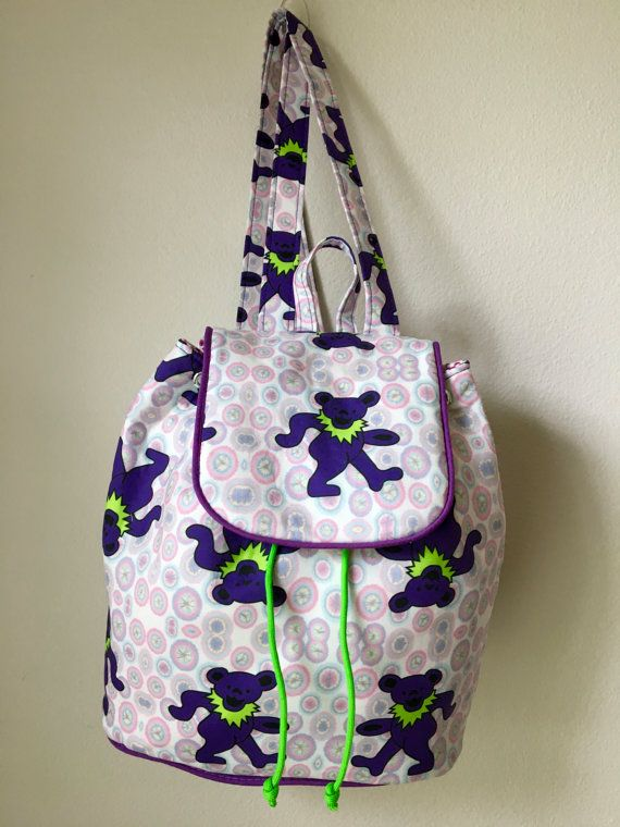 Ornament from above. Natural shiny cotton fabric Flap bag with magnetic snap