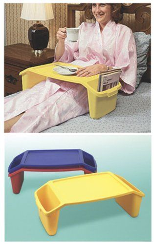 """Maddak Plastic Bed Tray with Pockets by Maddak Inc. $29.99. The tray has 17"""" wide leg room. Use it for eating, reading, writing, grooming and playing games in bed. Come in assorted colors, Merchant/shipper will chose color.. Use it for eating, reading, writing, grooming and playing games in bed. Side pockets provide ample space for books, magazines, cards and make-up kits. Side handles make carrying and handling easy. The tray has 17¨ (43 cm) wide leg room and a 11 x..."""