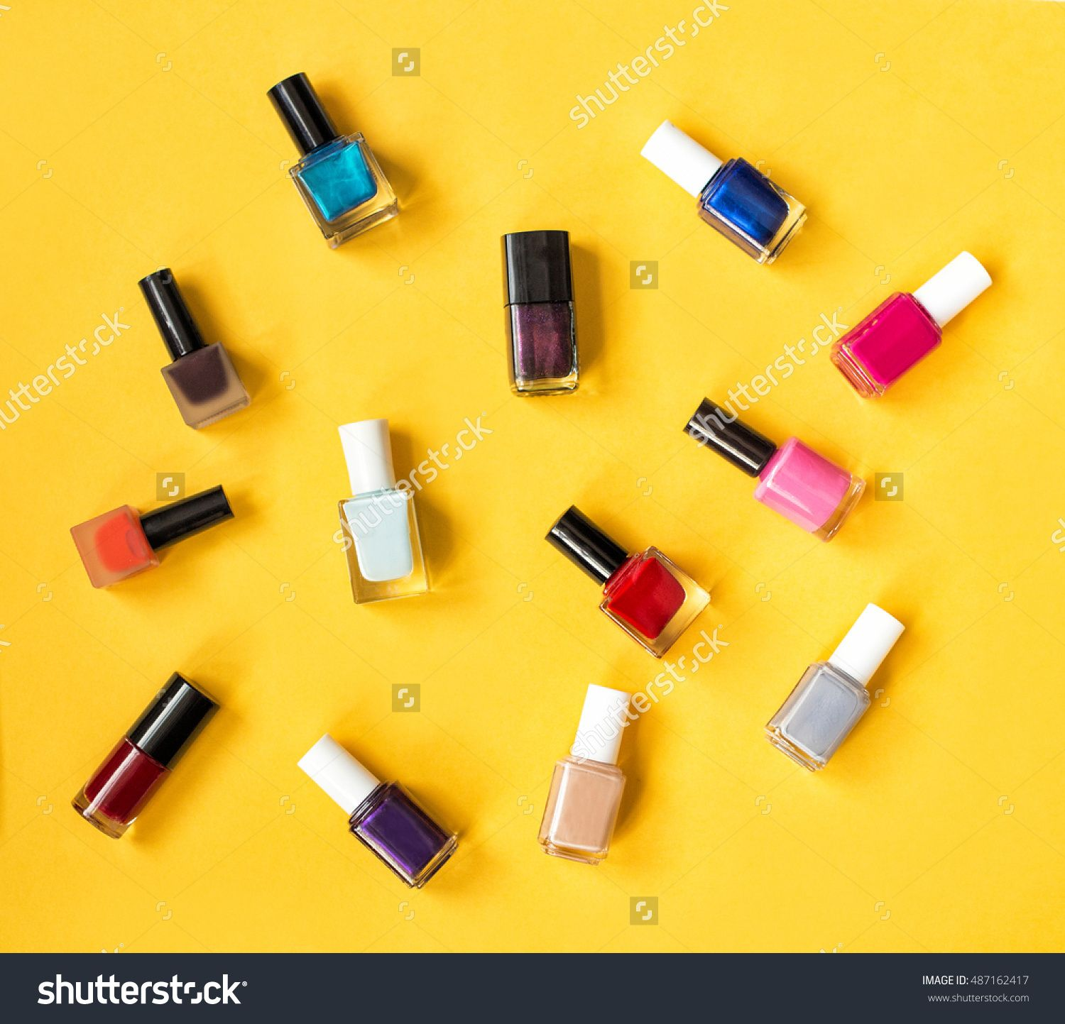 Set Of Make Up Items Of Different Colors And Shapes Isolated On Bright Yellow Background. Colorful Nail Polish Collection Studio Shot. Set Of Color Nail Paints. Stock Photo 487162417 : Shutterstock