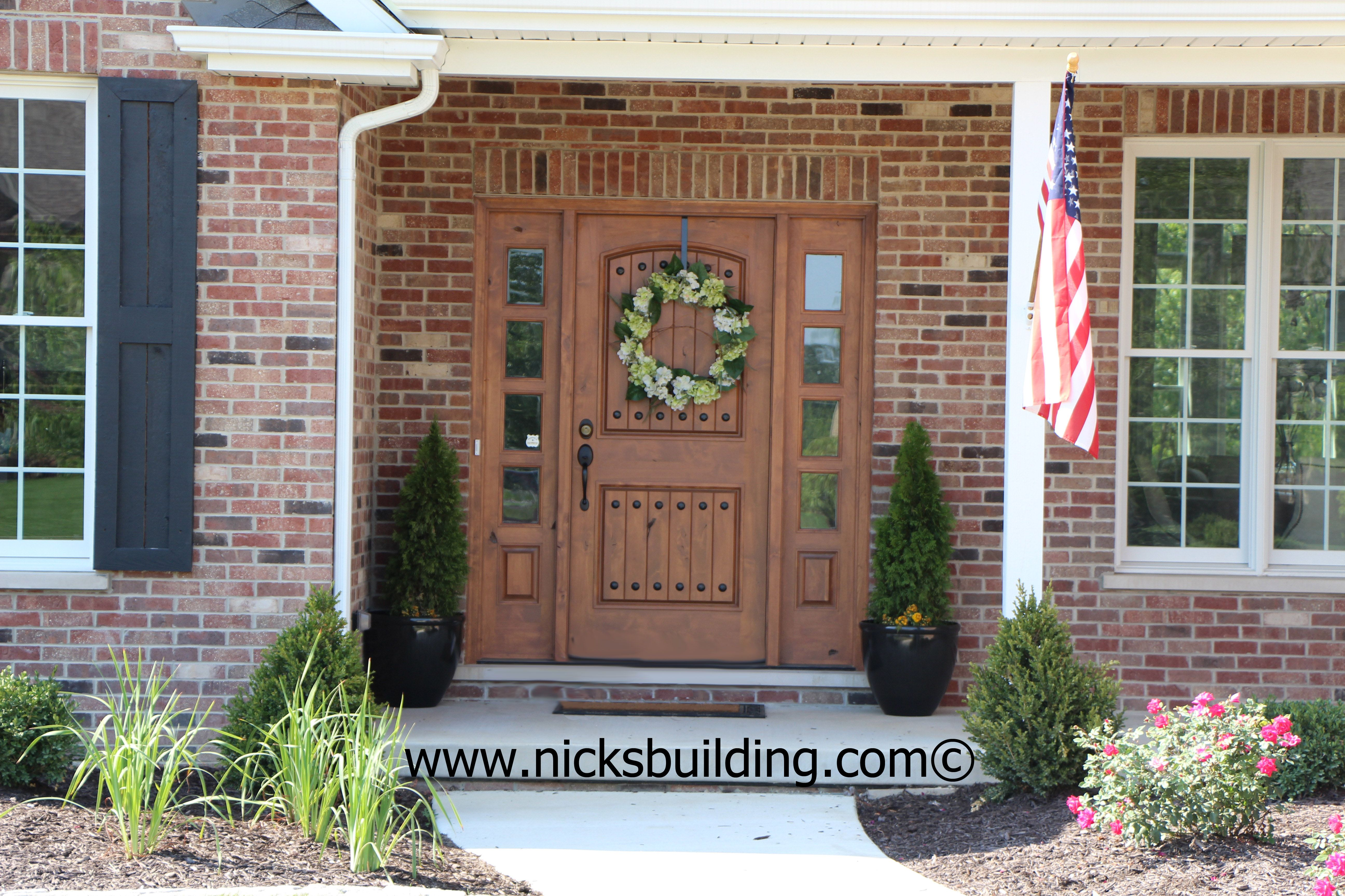 The great american entrance red brick house with tan door - Front door colors for brick houses ...