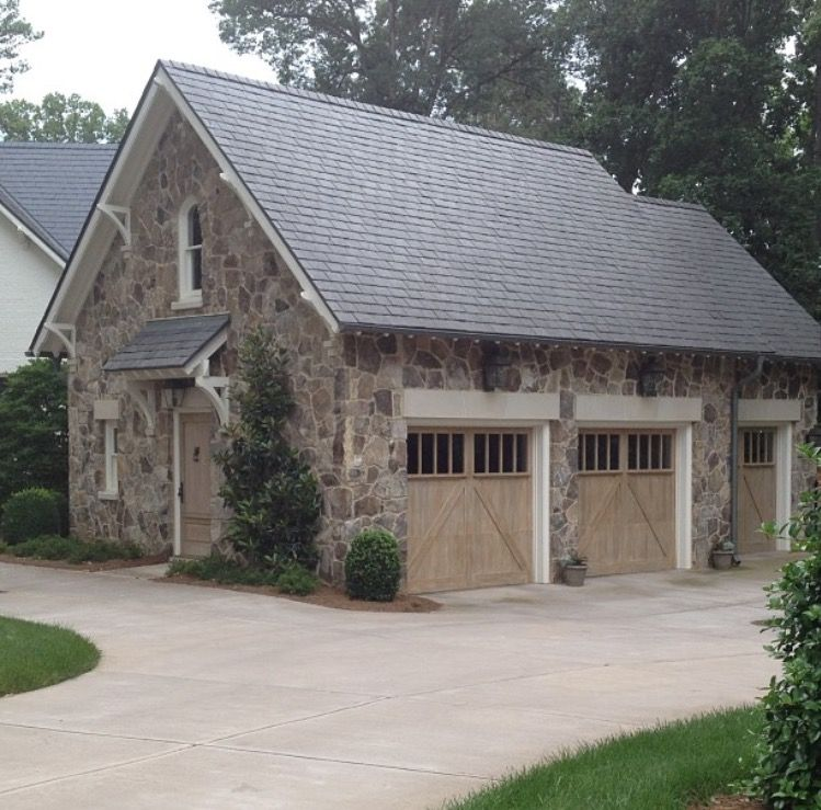 Stone Garage With Limestone Headers And Cerused Doors Garage Exterior Garage Door Design House Exterior