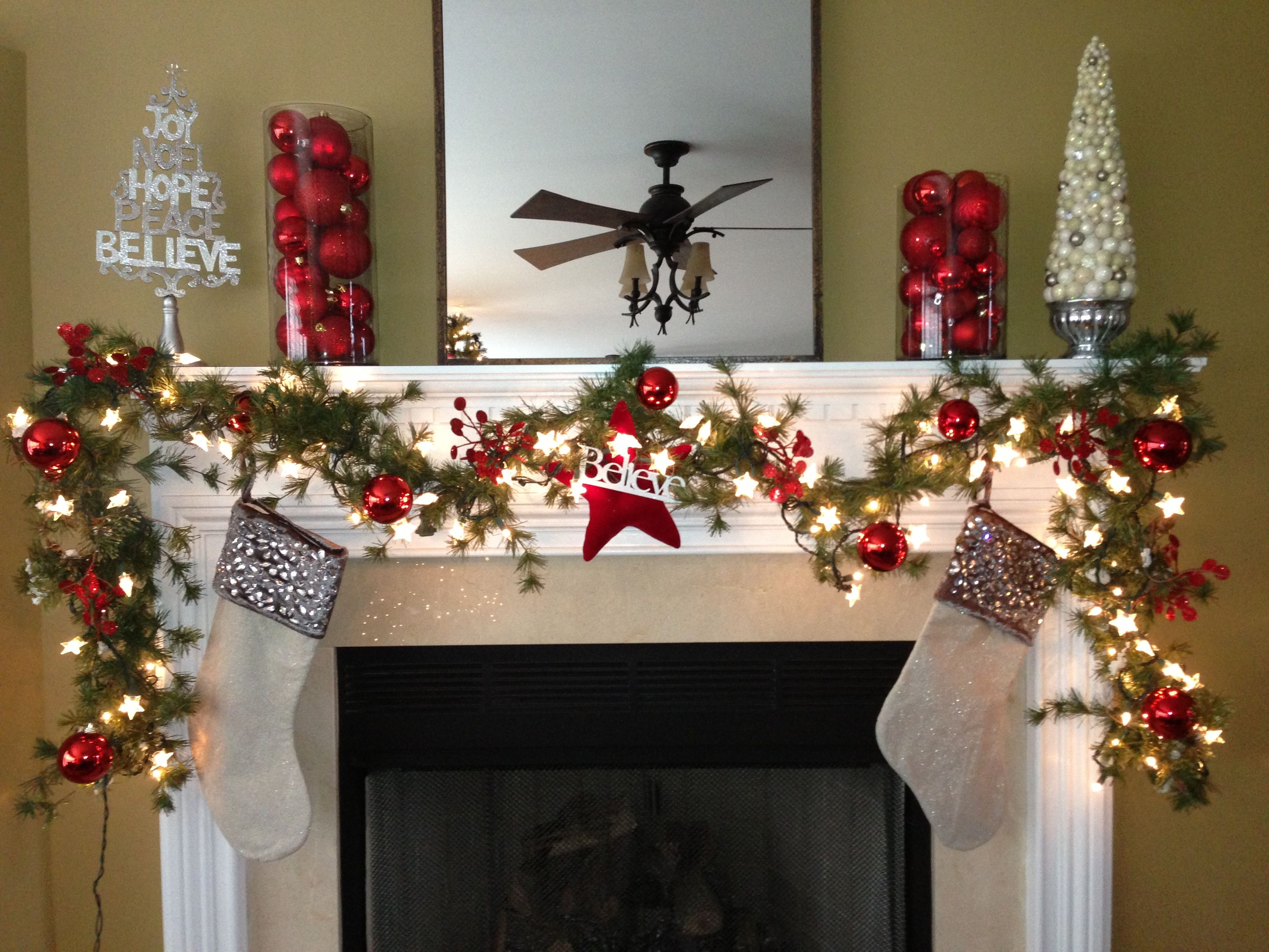 Christmas fireplace mantle Love to incorporate those trees and the glass  hurricanes with ornaments.
