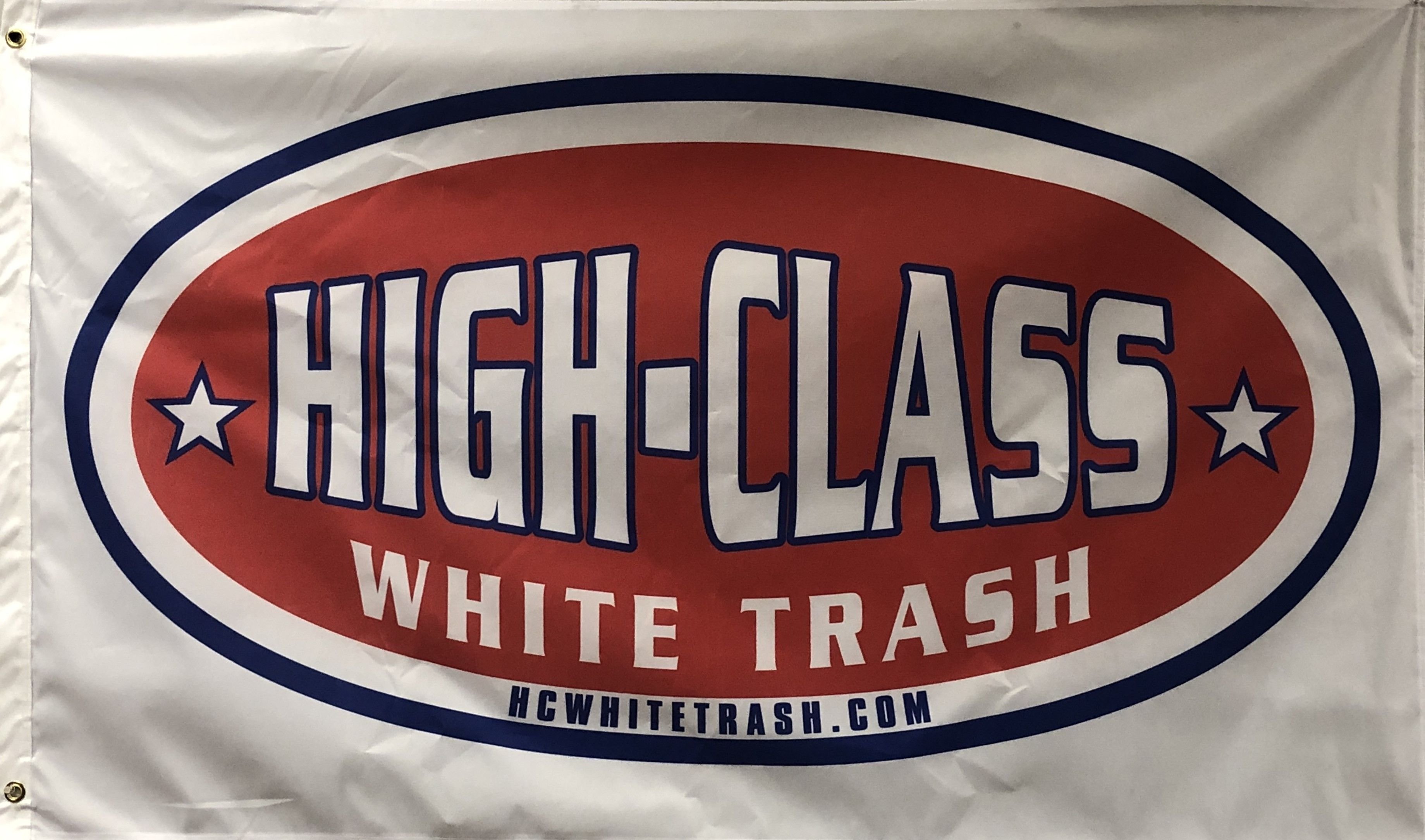 Get the official HCWT Flag. MADE IN U.S.A. Single Sided HCWT Flag. Made of durable HEAVYWEIGHT knit polyester this HCWT flag is made for long lasting OUTDOOR use. The canvas heading is reinforced with brass grommets. Flag color is white.  Join the HCWT Movement! #highclasswhitetrash #apparel #clothing #redneck #camping #fishing #hunting