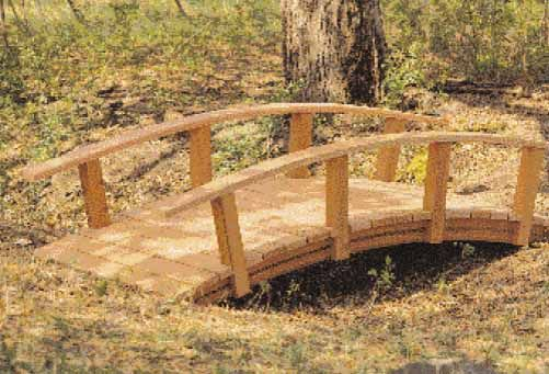a little wooden bridge is always special. Have flower carpet roses and rose  of sharons