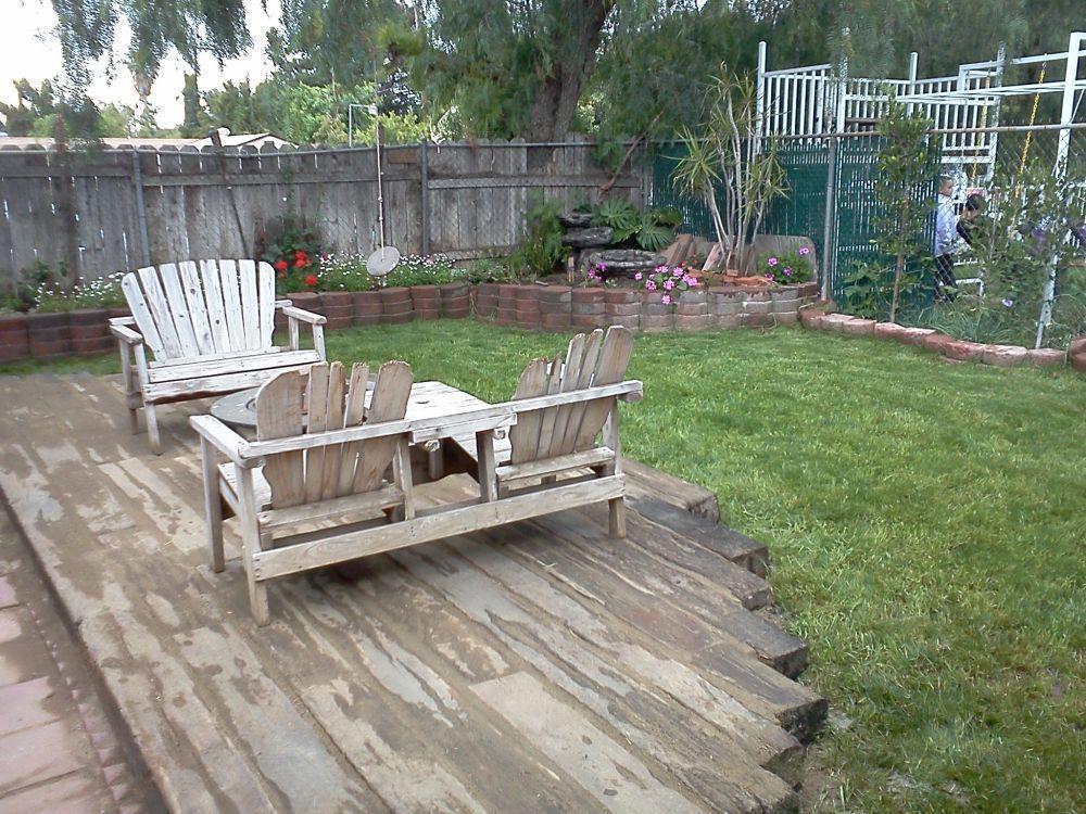 Railroad tie patio yard ideas pinterest railroad for Garden decking sleepers