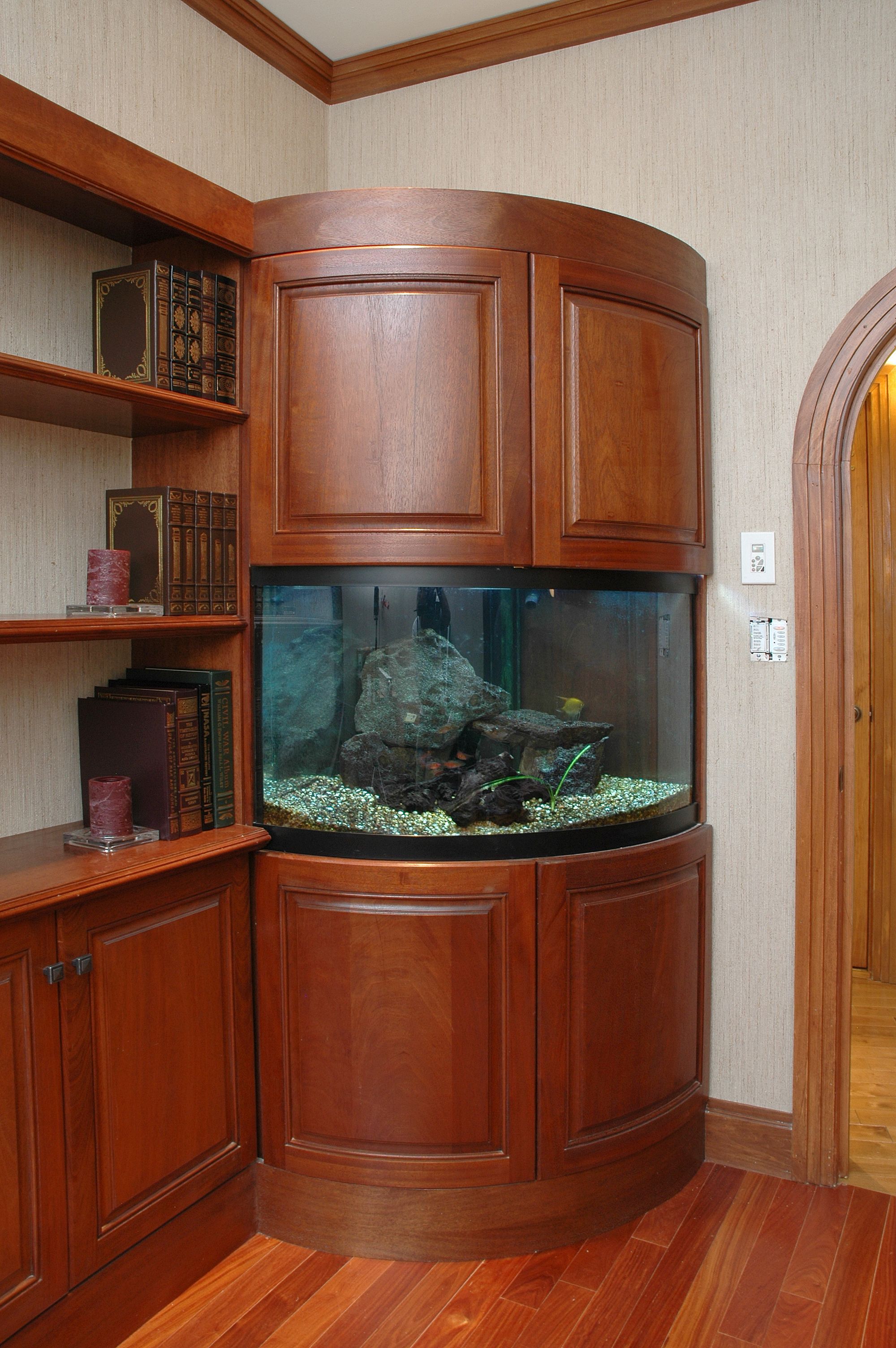 Amazing fish tank featuring decore radius doors cabinet for Fish tank cabinets