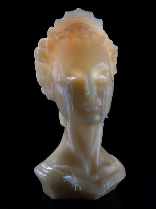 Weeping Bust of Dierdre Candle When lit, melting wax flows through the eyes opening of this neo-classical bust, giving the appearance of tears.