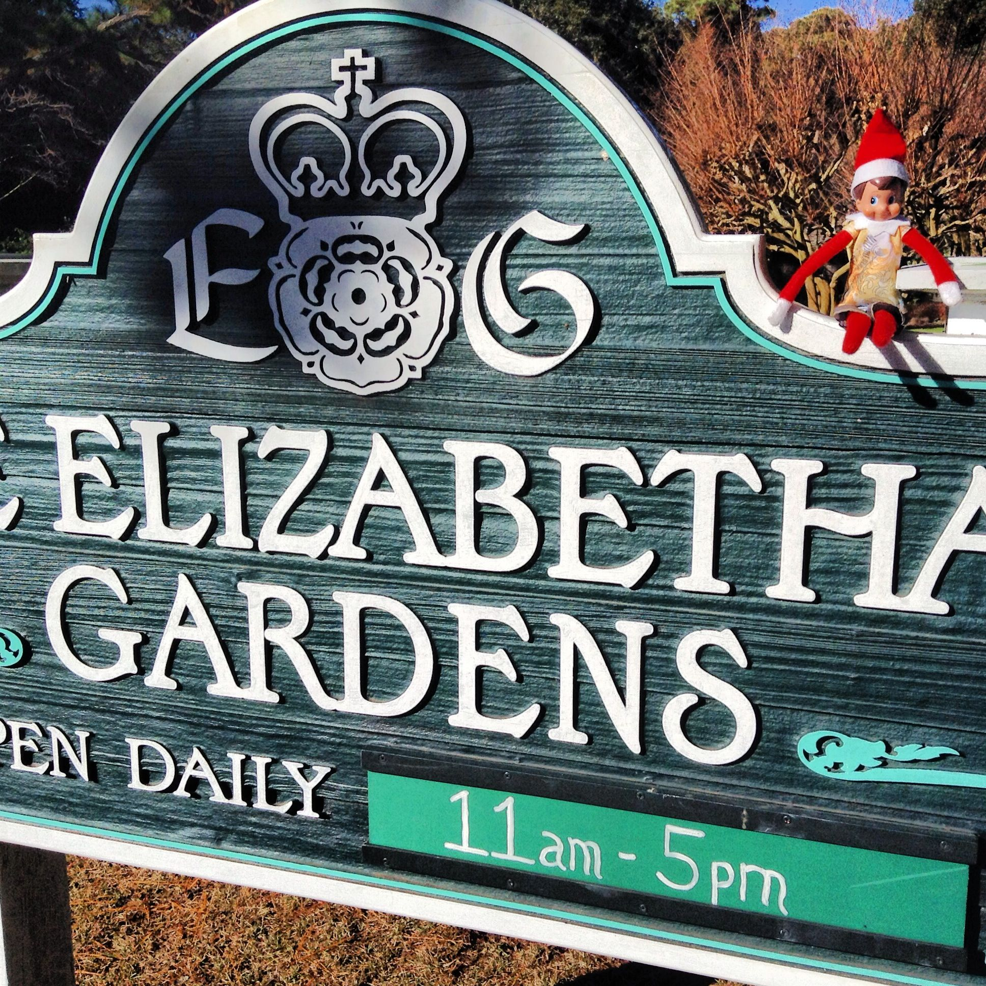 Sunny, the Sun Realty elf, visited the Elizabethan Gardens.