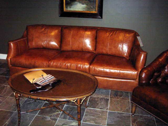 Saddle Color Leather Sofa With A Darker Brown Chair