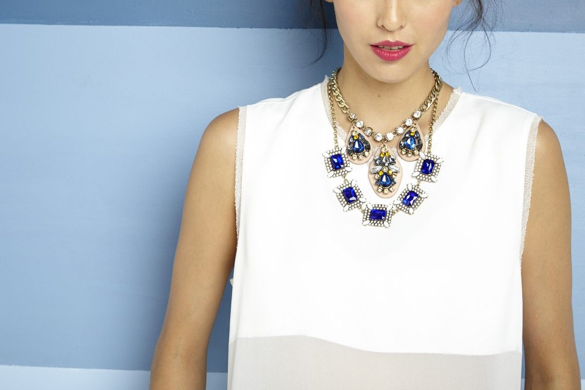 Statement necklace with geometric design, preciosa crystals and glass stones. Includes adjustable clasp closure.