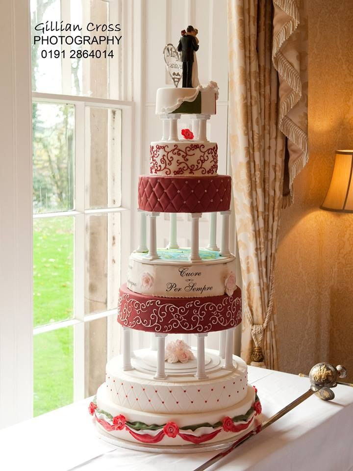 A Large 7 Tier Italian Themed Wedding Cake With A Hand Painted Map