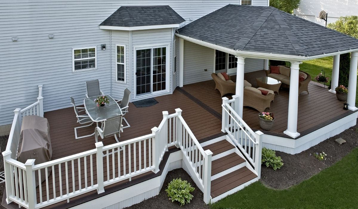 Trex deck with hip roof and grill bump out amazing for Roof deck design
