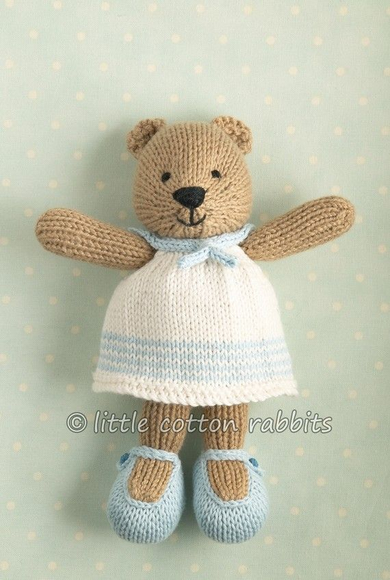 'camel' Rowan wool cotton yarn (50% merino wool, 50% cotton). Her clothes are all 100% cotton 4ply, her dress is in 'baby' and 'cream', knic...